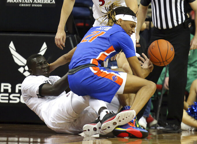 Boise State's Derrick Alston (21) and San Diego State's Aguek Arop (3) become entangled during the second half of an NCAA college basketball game in the Mountain West Conference men's tournament Friday, March 6, 2020, in Las Vegas. (AP Photo/Isaac Brekken)