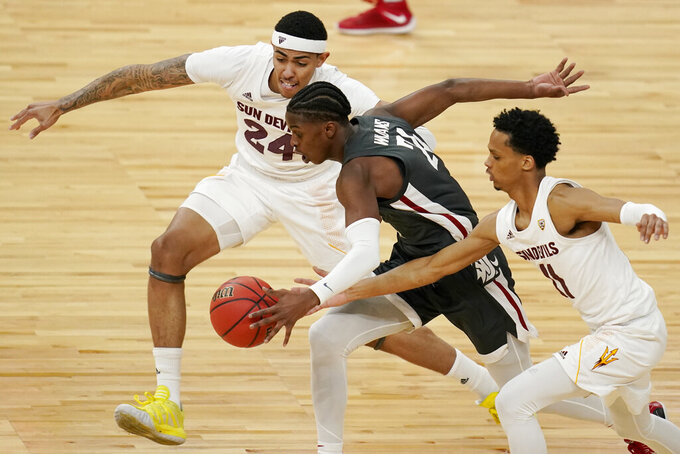 Arizona State's Jalen Graham, left, and Alonzo Verge Jr., right, guard Washington State's Noah Williams (24) during the first half of an NCAA college basketball game in the first round of the Pac-12 men's tournament Wednesday, March 10, 2021, in Las Vegas. (AP Photo/John Locher)