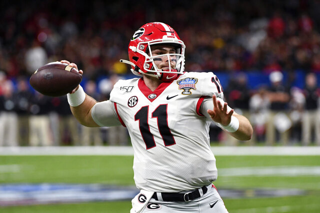Georgia quarterback Jake Fromm (11) passes in the first half of the Sugar Bowl NCAA college football game against Baylor in New Orleans, Wednesday, Jan. 1, 2020. (AP Photo/Bill Feig)