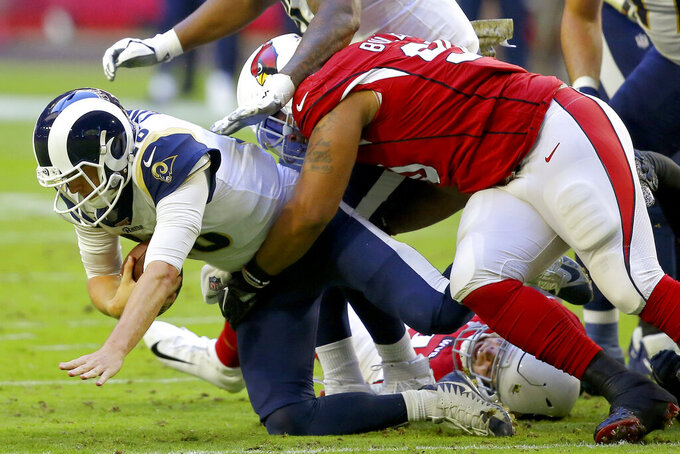Arizona Cardinals defensive end Jonathan Bullard sacks Los Angeles Rams quarterback Jared Goff, left, during the first half of an NFL football game, Sunday, Dec. 1, 2019, in Glendale, Ariz. (AP Photo/Ross D. Franklin)