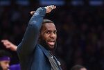 Los Angeles Lakers' LeBron James gestures from the bench during the second half of an NBA basketball game against the Cleveland Cavaliers Sunday, Jan. 13, 2019, in Los Angeles. The Cavaliers won 101-95. (AP Photo/Mark J. Terrill)
