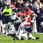 Mississippi quarterback Matt Corral is tackled by Mississippi State safety C.J. Morgan (29) during an NCAA college football game in Oxford, Miss., Thursday, Nov. 22, 2018. (Bruce Newman/The Oxford Eagle via AP)