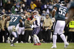 New England Patriots' Julian Edelman (11) throws a touchdown pass during the second half of an NFL football game against the Philadelphia Eagles, Sunday, Nov. 17, 2019, in Philadelphia. (AP Photo/Matt Rourke)