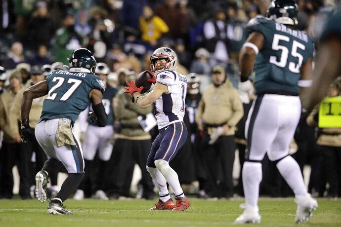 New England Patriots' Julian Edelman (11) throws a touchdown pass during the second half of an NFL football game against the Philadelphia Eagles, Sunday, Nov. 17, 2019, in Philadelphia. (AP Photo/Matt Rourke)