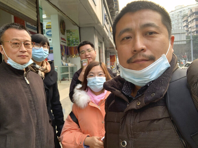 In this photo taken by Ren Quanniu, Ren Quanniu, right, and other supporters of lawyer Lu Si Wei pose for a group photo in Chengdu in southwestern China's Sichuan Province, Wednesday, Jan. 13, 2021. A Chinese lawyer who represented a Hong Kong pro-democracy activist was stripped of his law license on Friday, Jan. 15, 2021 amid efforts by Beijing to crush opposition to its tighter control over the territory. (Ren Quanniu via AP)