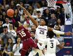 Connecticut's Josh Carlton (25) defends against Temple's Nate Pierre-Louis (15) in the second half of an NCAA college basketball game, Thursday, March 7, 2019, in Storrs, Conn. (AP Photo/Stephen Dunn)