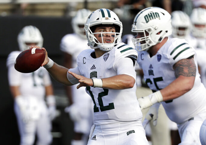 Ohio quarterback Nathan Rourke (12) passes against Virginia in the first half of an NCAA college football game Saturday, Sept. 15, 2018, in Nashville, Tenn. (AP Photo/Mark Humphrey)