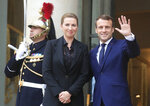 Denmark's Prime Minister Mette Fredriksen, left, is welcomed by French President Emmanuel Macron for a lunch at the Elysee Palace in Paris, Monday, Nov. 18, 2019. Denmark's Prime Minister Mette Fredriksen is in Paris for bilateral talks. (AP Photo/Michel Euler)
