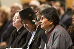 Bolivian President Evo Morales, right, listens Greece's Prime Minister Alexis Tsipras, during a conference in Athens, Thursday, March 14, 2019. Morales is in Greece on a two-day official visit. (AP Photo/Petros Giannakouris)