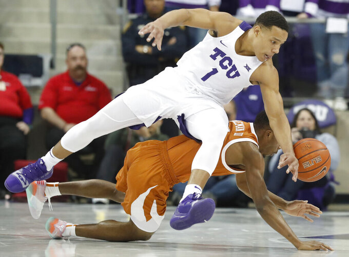 TCU guard Desmond Bane (1) and Texas guard Matt Coleman III (2) vie for control of the ball during the first half of an NCAA college basketball game in Fort Worth, Texas, Wednesday, Jan. 23, 2019. (AP Photo/LM Otero)