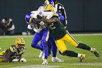 Green Bay Packers' Rashan Gary (52) sacks Los Angeles Rams quarterback Jared Goff during the second half of an NFL divisional playoff football game Saturday, Jan. 16, 2021, in Green Bay, Wis. (AP Photo/Mike Roemer)