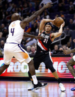 Portland Trail Blazers guard Seth Curry (31) looks to pass the ball as Phoenix Suns forward Quincy Acy (4) defends during the second half of an NBA basketball game Thursday, Jan. 24, 2019, in Phoenix. (AP Photo/Matt York)