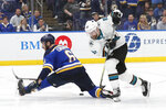 San Jose Sharks right wing Joonas Donskoi (27), of Finland, moves the puck past St. Louis Blues defenseman Joel Edmundson (6) during overtime in Game 3 of the NHL hockey Stanley Cup Western Conference final series Wednesday, May 15, 2019, in St. Louis. (AP Photo/Jeff Roberson)