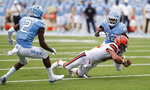 Syracuse quarterback Tommy DeVito (13) dives for extra yardage in the first half of an NCAA college football game in Chapel Hill, N.C. Saturday, Sept. 13, 2020. (Robert Willett/The News & Observer via AP, Pool)