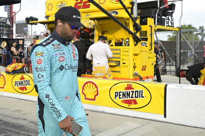 Driver Bubba Wallace walks to his car on pit road before a NASCAR Cup Series auto race at Daytona International Speedway, Saturday, Aug. 28, 2021, in Daytona Beach, Fla. (AP Photo/Phelan M. Ebenhack)