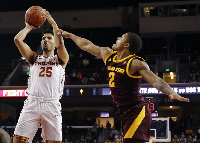 Southern California forward Bennie Boatwright (25) shoots next to Arizona State guard Rob Edwards (2) during the first half of an NCAA college basketball game Saturday, Jan. 26, 2019, in Los Angeles. (AP Photo/Marcio Jose Sanchez)