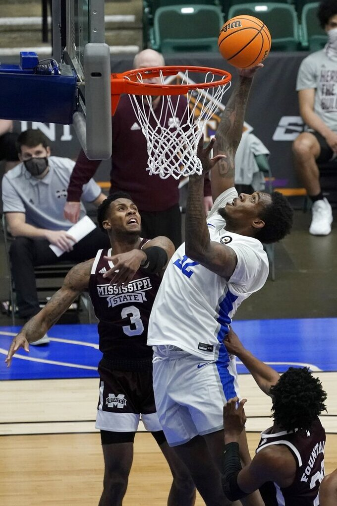 Saint Louis forward Jimmy Bell Jr. (32) goes up for a shot over Mississippi State guard D.J. Stewart Jr. (3) in the first half of an NCAA college basketball game in the first round of the NIT, Saturday, March 20, 2021, in Frisco, Texas. (AP Photo/Tony Gutierrez)