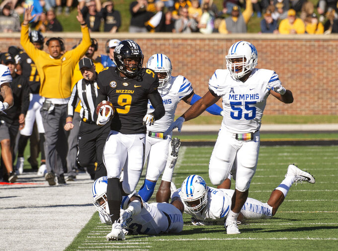 Missouri wide receiver Jalen Knox, left, runs down the sideline chased by Memphis's Bryce Huff, right, and other defenders during the first half of an NCAA college football game Saturday, Oct. 20, 2018, in Columbia, Mo. (AP Photo/L.G. Patterson)