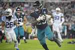 Jacksonville Jaguars running back Ryquell Armstead, front right, makes a reception for a 3-yard touchdown in front of Indianapolis Colts safety Clayton Geathers (26) during the second half of an NFL football game, Sunday, Dec. 29, 2019, in Jacksonville, Fla. (AP Photo/Phelan M. Ebenhack)