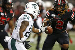 Michigan State running back Elijah Collins, left, fumbles the ball in front of Ohio State defensive end Chase Young during the first half of an NCAA college football game Saturday, Oct. 5, 2019, in Columbus, Ohio. (AP Photo/Jay LaPrete)