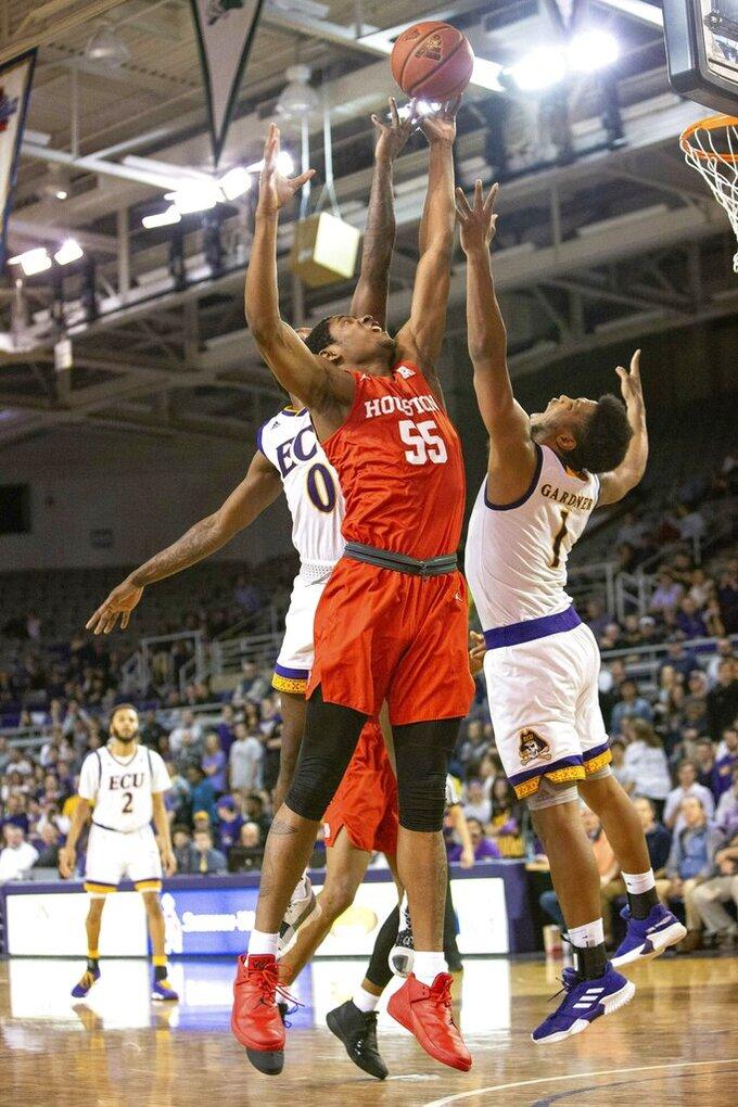 Houston's Brison Gresham (55) battles East Carolina's Isaac Fleming (0) and Jayden Gardner (1) for a rebound during the second half of an NCAA college basketball game in Greenville, N.C., Wednesday, Feb. 27, 2019. (AP Photo/Ben McKeown)