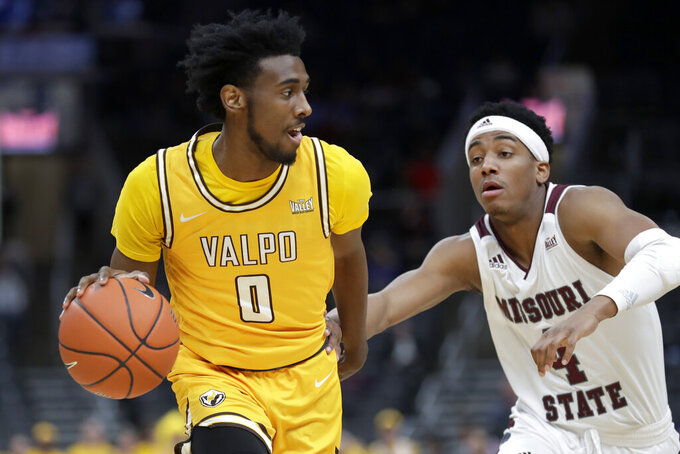 Valparaiso's Javon Freeman-Liberty (0) drives past Missouri State's Ja'Monta Black during the first half of an NCAA college basketball game in the semifinal round of the Missouri Valley Conference men's tournament Saturday, March 7, 2020, in St. Louis. (AP Photo/Jeff Roberson)