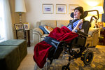 Lauren Roesky, who is 31 and has cerebral palsy, smiles in her living room at home in Metairie, La., Friday, Sept. 17, 2021. Lauren's mother, Sue Roesky, is concerned with extended power outages after hurricanes because how much they rely on electricity to tend to Lauren's needs. (Sophia Germer/The Times-Picayune/The New Orleans Advocate via AP)