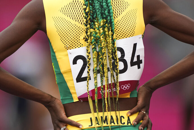 Natoya Goule, of Jamaica, prepares to race in her heat of the women's 800-meters at the 2020 Summer Olympics, Friday, July 30, 2021, in Tokyo. (AP Photo/Matthias Schrader)