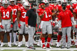 Ohio State head coach Ryan Day, left, talk with quarterback Justin Fields during the second half of their NCAA college football game against Nebraska Saturday, Oct. 24, 2020, in Columbus, Ohio. Ohio State defeated Nebraska 52-17. (AP Photo/Jay LaPrete)
