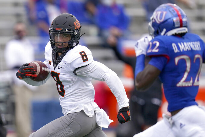 Oklahoma State wide receiver Braydon Johnson (8) runs for a touchdown past Kansas cornerback Duece Mayberry (22) during the first half of an NCAA college football game in Lawrence, Kan., Saturday, Oct. 3, 2020. (AP Photo/Orlin Wagner)
