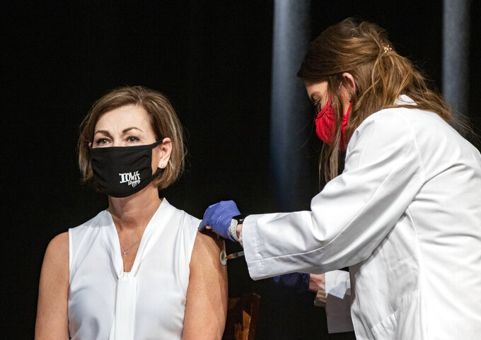 Iowa Governor Kim Reynolds gets the Johnson & Johnson COVID-19 vaccine during a news conference at Iowa PBS in Johnston, Iowa Wednesday, March 3, 2021. (Zach Boyden-Holmes/The Des Moines Register via AP)