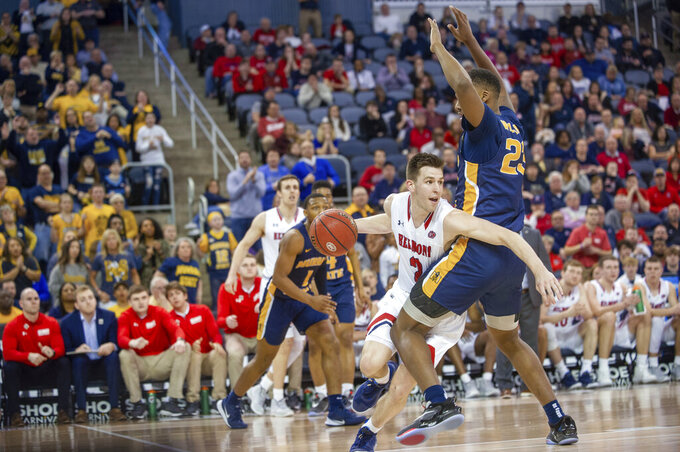 Belmont's Grayson Murphy (2) moves around Murray State's KJ Williams (23) during the second half of an NCAA college basketball game for the championship of the Ohio Valley Conference men's tournament Saturday, March 7, 2020, in Evansville, Ind. (AP Photo/Daniel R. Patmore)