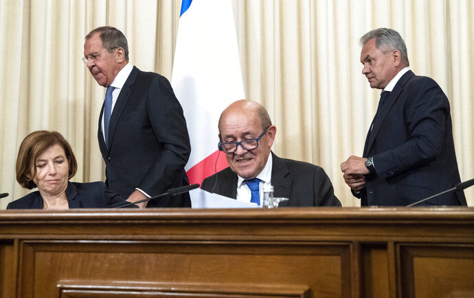 From left, France Defence Minister Florence Parly, Russian Foreign Minister Sergey Lavrov, France Foreign Minister Jean-Yves Le Drian and Russian Defence Minister Sergei Shoigu leave a news conference during their meeting in Moscow, Russia, Monday, Sept. 9, 2019. (AP Photo/Pavel Golovkin)
