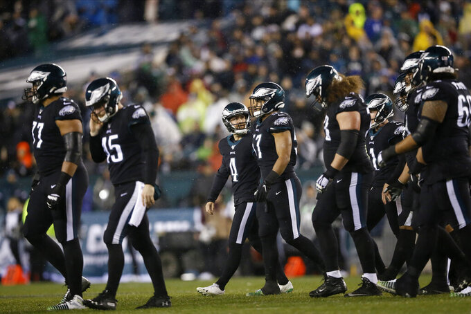 Philadelphia Eagles' Jake Elliott (4) walks off the field after missing a field goal during the second half of an NFL football game against the New York Giants, Monday, Dec. 9, 2019, in Philadelphia. (AP Photo/Michael Perez)
