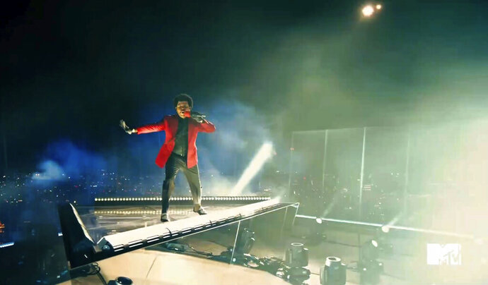 In this video grab issued Sunday, Aug. 30, 2020, by MTV, The Weeknd performs