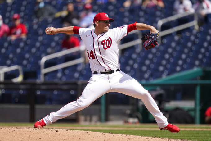 Washington Nationals relief pitcher Daniel Hudson throws during the eighth inning of a baseball game against the Philadelphia Phillies at Nationals Park, Thursday, May 13, 2021, in Washington. The Nationals won 5-1. (AP Photo/Alex Brandon)