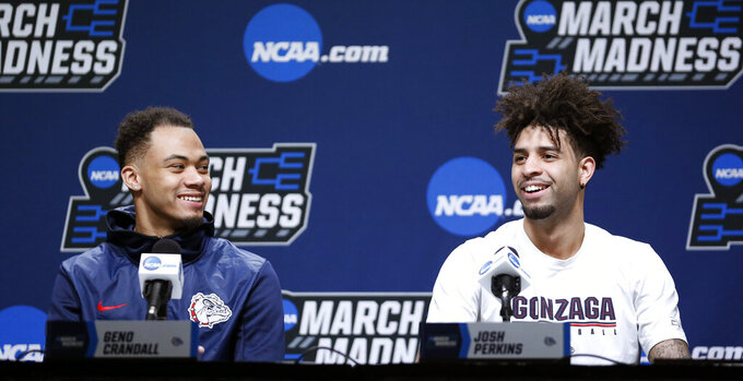 Gonzaga's Geno Crandall, left, and Josh Perkins, right, speak during a news conference at the NCAA men's college basketball tournament Wednesday, March 20, 2019, in Salt Lake City. (AP Photo/Rick Bowmer)