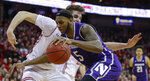 Northwestern's Dererk Pardon (5) drives against Wisconsin's Nate Reuvers (35) during the first half of an NCAA college basketball game Saturday, Jan. 26, 2019, in Madison, Wis. (AP Photo/Andy Manis)