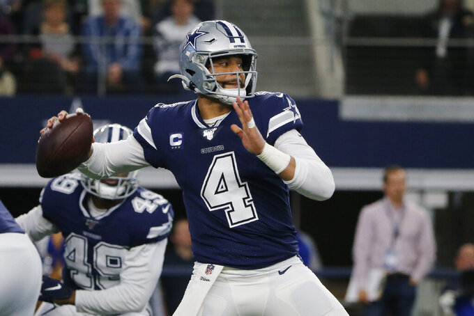 FILE - In this Dec. 15, 2019, file photo, Dallas Cowboys quarterback Dak Prescott (4) looks to throw in the first quarter of an NFL football game against the Los Angeles Rams in Arlington, Texas. The Cowboys have their star quarterback under contract for the 2020 season. Prescott has signed his $31.4 million tender under the franchise tag. That would be the richest one-year contract in franchise history. (AP Photo/Michael Ainsworth, File)