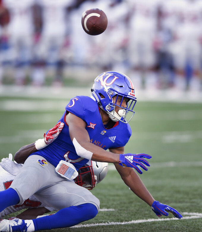 Nicholls State defensive back Jonavon Lewis (27) knocks away this pass to Kansas wide receiver Stephon Robinson (5) during the first quarter of an NCAA college football game in Lawrence, Kan., Saturday, Sept. 1, 2018. (AP Photo/Reed Hoffmann)
