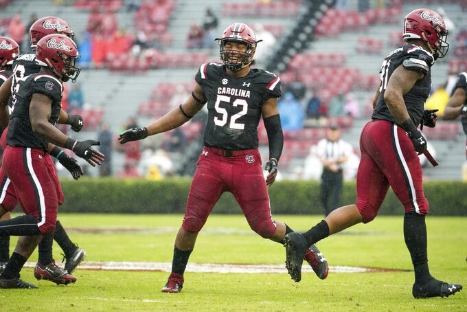 South Carolina defensive lineman Kingsley Enagbare (52) celebrates a defensive stop against Akron during the first half of an NCAA college football game Saturday, Dec. 1, 2018, in Columbia, S.C. South Carolina defeated Akron 28-3. (AP Photo/Sean Rayford)