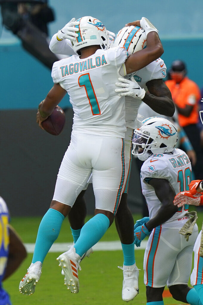 Miami Dolphins quarterback Tua Tagovailoa (1) and wide receiver DeVante Parker (11) celebrate their touchdown during the first half of an NFL football game against the Los Angeles Rams, Sunday, Nov. 1, 2020, in Miami Gardens, Fla. (AP Photo/Lynne Sladky)