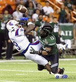 Hawaii defensive back Khoury Bethley (13) breaks up a pass intended for Louisiana Tech wide receiver Teddy Veal (9) in the first half of the Hawaii Bowl NCAA college football game, Saturday, Dec. 22, 2018, in Honolulu. (AP Photo/Eugene Tanner)