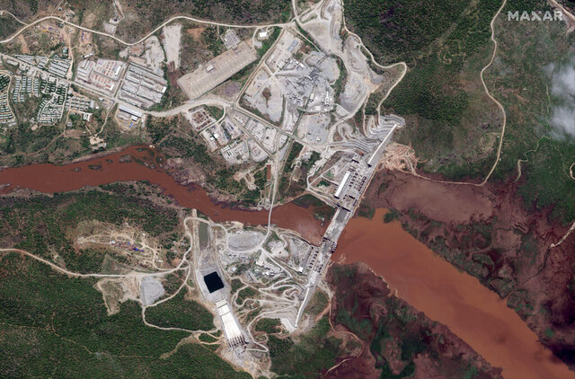 This satellite image taken Thursday, May 28, 2020, shows the Grand Ethiopian Renaissance Dam on the Blue Nile river in the Benishangul-Gumuz region of Ethiopia. In an interview with The Associated Press Friday, June 19, 2020, Ethiopia's Foreign Minister Gedu Andargachew declared that his country will go ahead and start filling the $4.6 billion Grand Ethiopian Renaissance Dam next month, even without an agreement with Egypt and Sudan. (Maxar Technologies via AP)