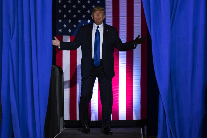 President Donald Trump arrives at UW-Milwaukee Panther Arena to speak at a campaign rally, Tuesday, Jan. 14, 2020, in Milwaukee. (AP Photo/ Evan Vucci)