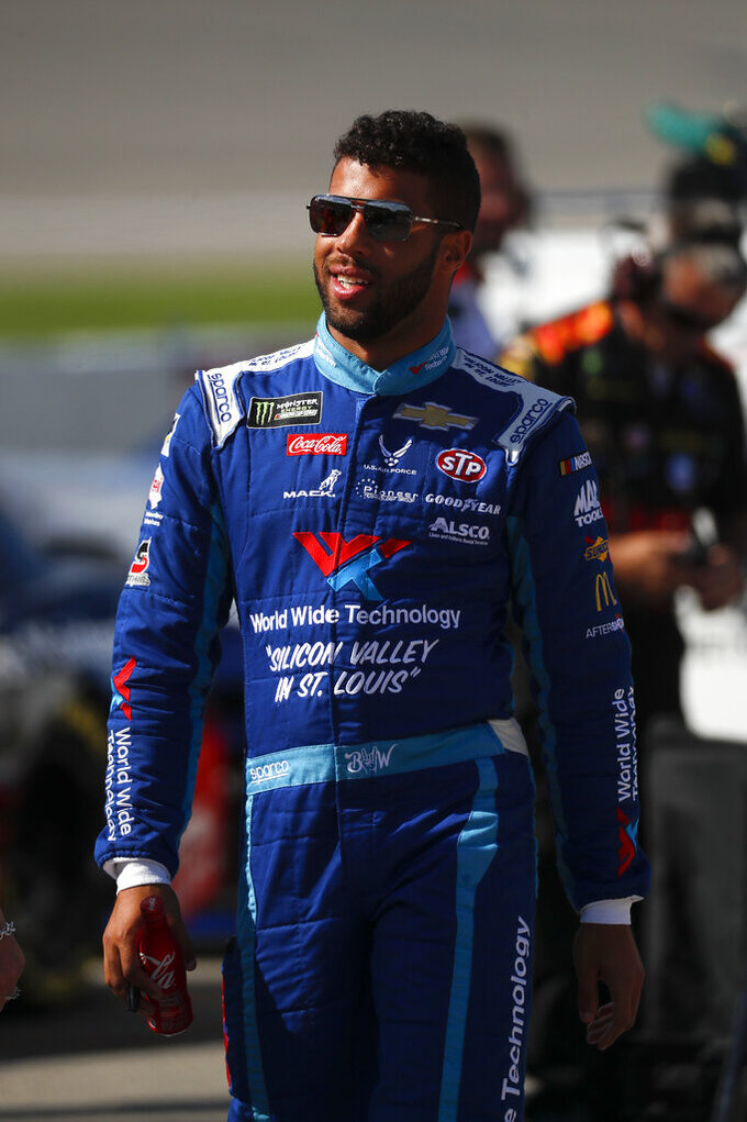 Bubba Wallace watches qualifications for a NASCAR Cup Series auto race at Michigan International Speedway in Brooklyn, Mich., Friday, Aug. 9, 2019. (AP Photo/Paul Sancya)