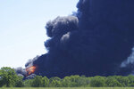 Flames and smoke are seen from an explosion at a chemical plant in Rockton, Ill., Monday, June 14, 2021. (Stacey Wescott/Chicago Tribune via AP)
