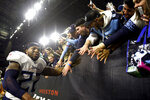 Tennessee Titans running back Derrick Henry (22) celebrates with fans after an NFL football game against the Houston Texans Sunday, Dec. 29, 2019, in Houston. Henry moved into first place for the season rushing title on a 53-yard touchdown run during the fourth quarter. The Titans won 35-14. (AP Photo/Eric Christian Smith)