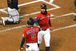 Minnesota Twins Byron Buxton, right, gives an elbow to Marwin Gonzalez after hitting a two-run home run against the Cleveland Indians during the second inning of a game Friday, Sept. 11, 2020, in Minneapolis. (AP Photo/Craig Lassig)