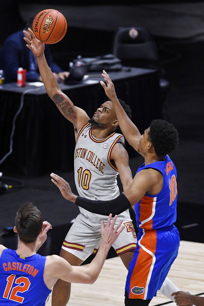 Boston College's Wynston Tabbs (10) goes up for a basket as Florida's Noah Locke, right, defends in the first half of an NCAA college basketball game, Thursday, Dec. 3, 2020, in Uncasville, Conn. (AP Photo/Jessica Hill)